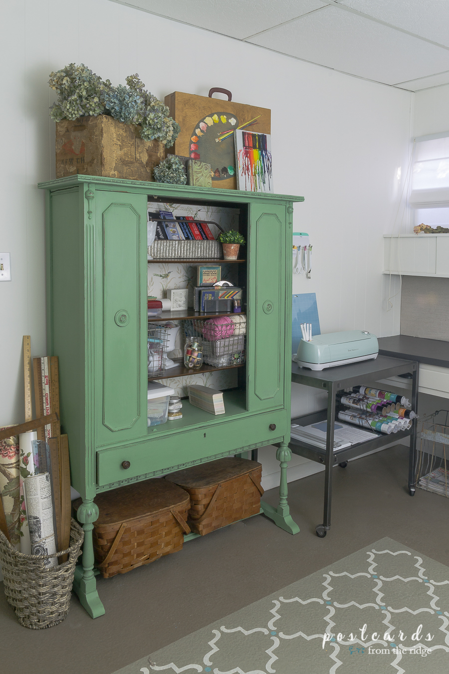 green painted vintage China cabinet used for storing art supplies
