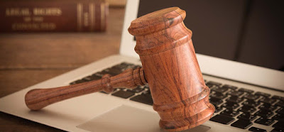 photo of judge's gavel on laptop representing Legal Forms by Gale
