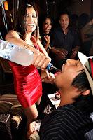 Guy taking a shot of vodka from a bottle