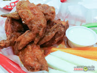 half dozen hot buffalo wings, Charlie's Grind and Grill
