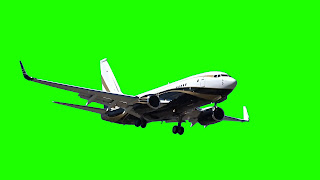 A photo of a Boeing jet masked against a green screen background.
