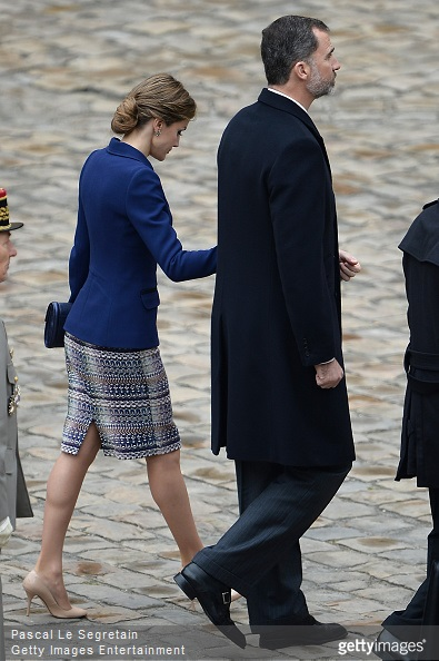 Queen Letizia of Spain and King Felipe of Spain wave to the crowd during a cermony in the courtyard of the Invalides as part of a three day official visit to France