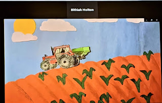 A paper tractor moving over a field of plants on a sunny day.