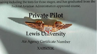 Joe Burlas receives his first pair of wings from Lewis University for earning his Private Pilots License