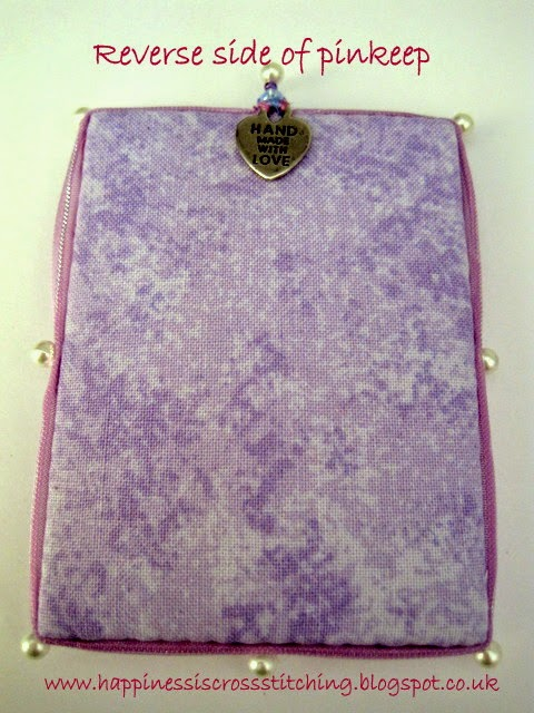 Reverse side of cross stitched pinkeep by Lynn B
