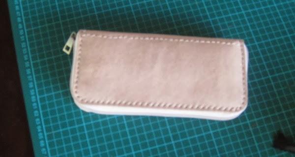 dompet kulit hasil pelatihan