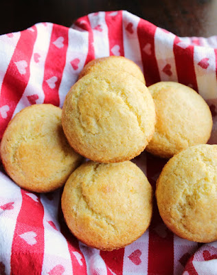 basket of golden brown corn muffins ready to eat