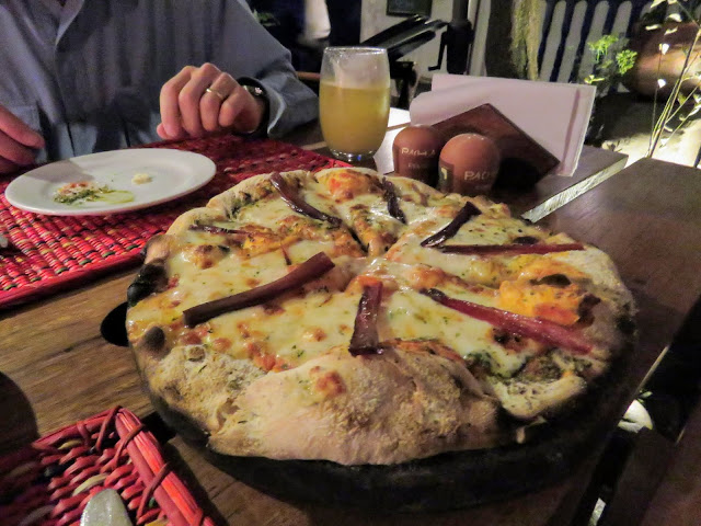 Cured alpaca pizza at Pachapapa in Cusco Peru