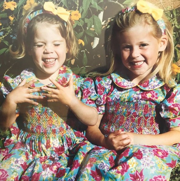 the princess and her younger sister, Eugenie, dressed up in floral-print dresses and matching hairbands