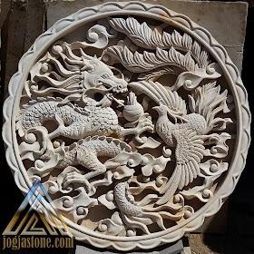Relief naga dan burung hong
