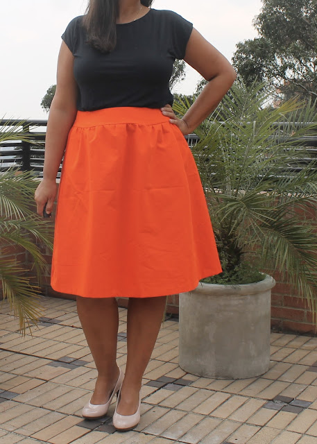 Orange faille skirt sewn from the Simplicity 1369 sewing pattern.