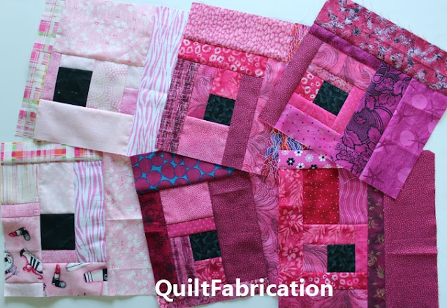 pink quilt blocks with a black center square
