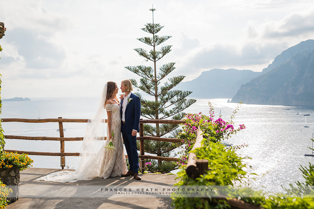 Bride and groom at hotel San Pietro with sea view