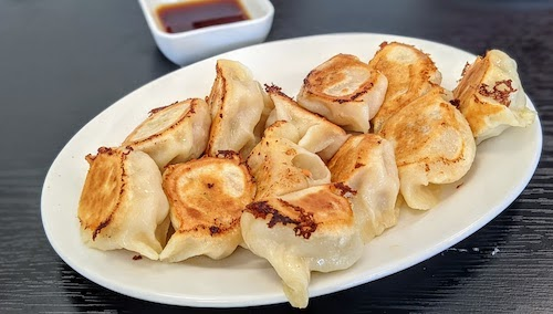 A combination of two orders: pork and napa cabbage dumplings and shrimp and chicken dumplings