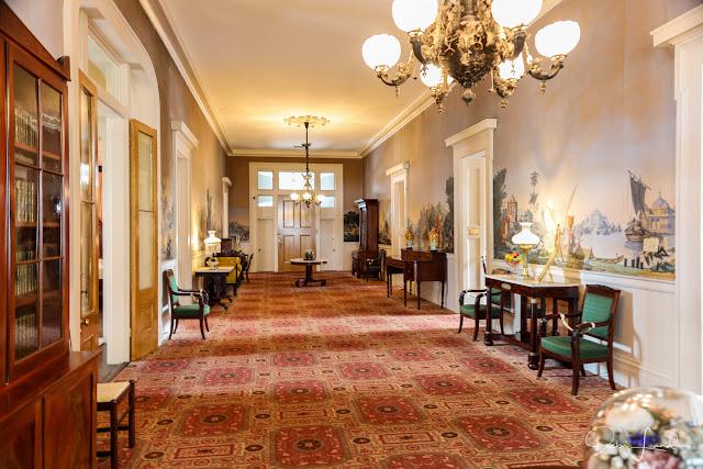 Upstairs hall in Stanton Hall features Zuber scenic wallpaper.