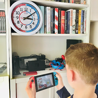 Our autistic son monitoring his time