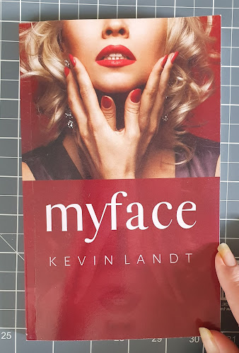 Myface by Kevin Landt book cover with woman's face reflected below. She wears lots of make up, appears emotional