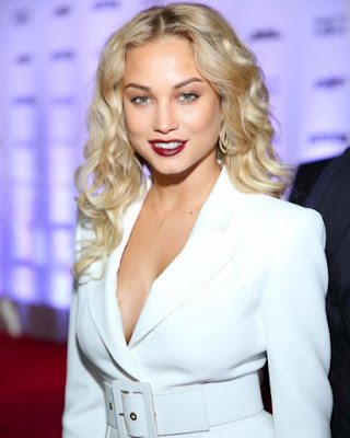 Rose Bertram wears white suit