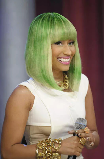 A Short Mixed Blonde And Green Colored Hair