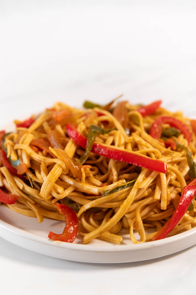 Profile photo of a plate of noodles with vegetables