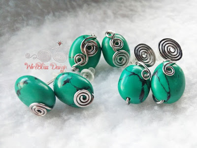 Turquoise wire wrapped earrings with lots of swirls