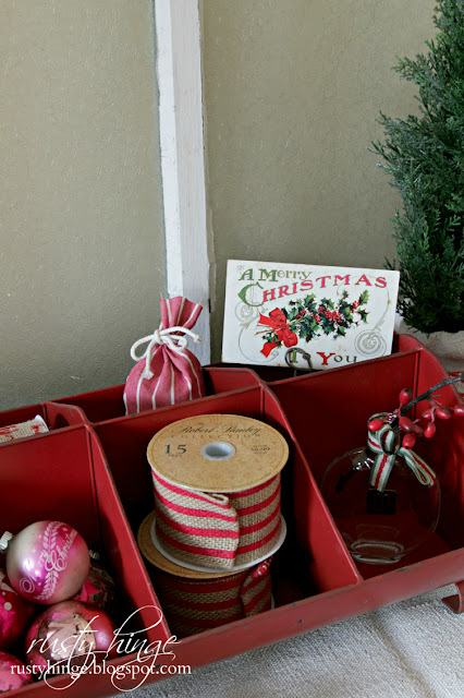 Red and white Christmas vignette in a divided metal tray