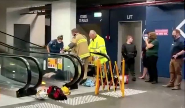 Woman gets trapped on escalator at shopping centre as she fell (video)