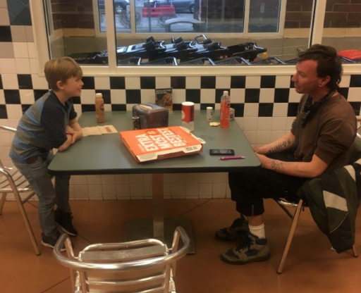 A boy asked his dad to help the homeless. Now, father and son take them out to lunch each week