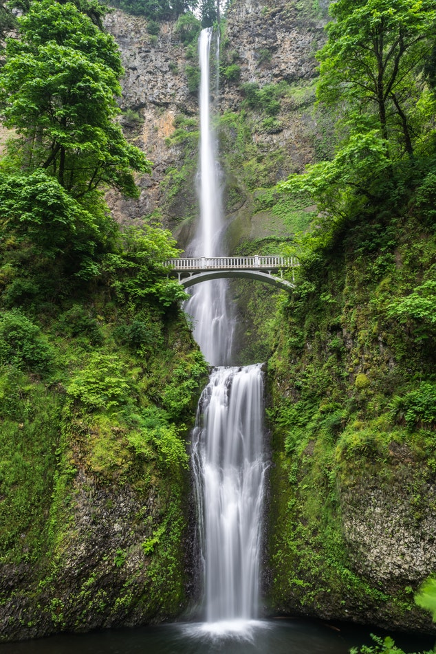 A waterfall between two mountains nature high resolution nature vertical