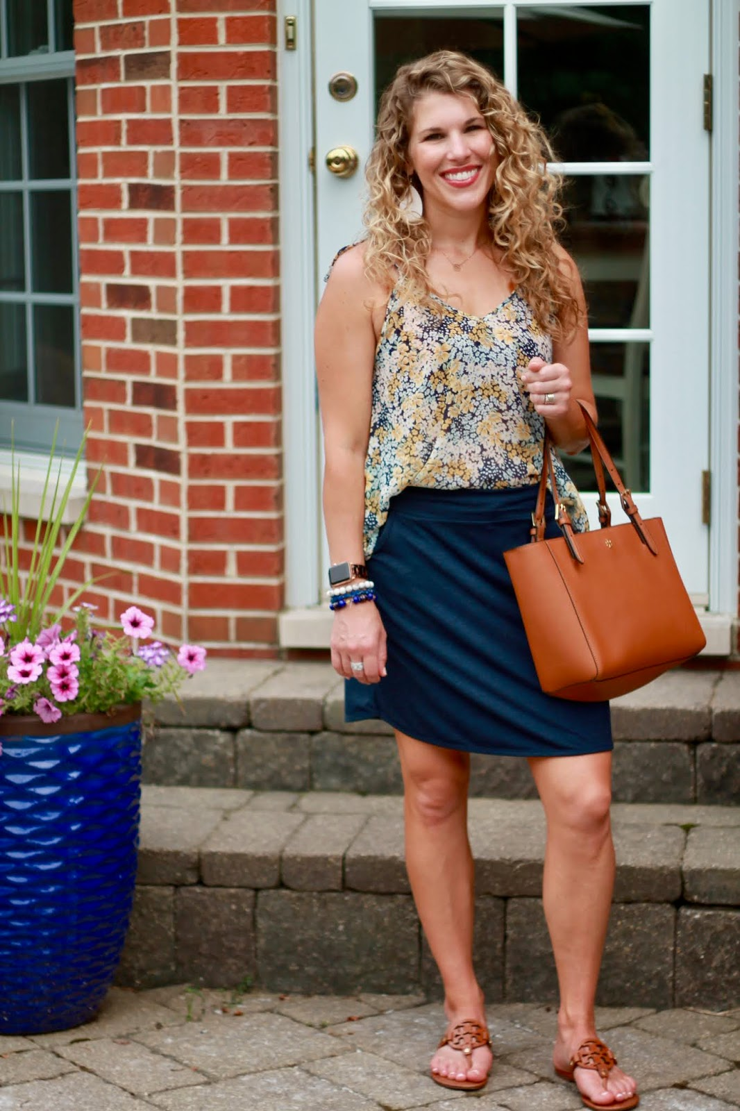navy aventura skirt, floral cami, tory burch miller sandals, tory burch cognac tote, casual summer skirt outfit