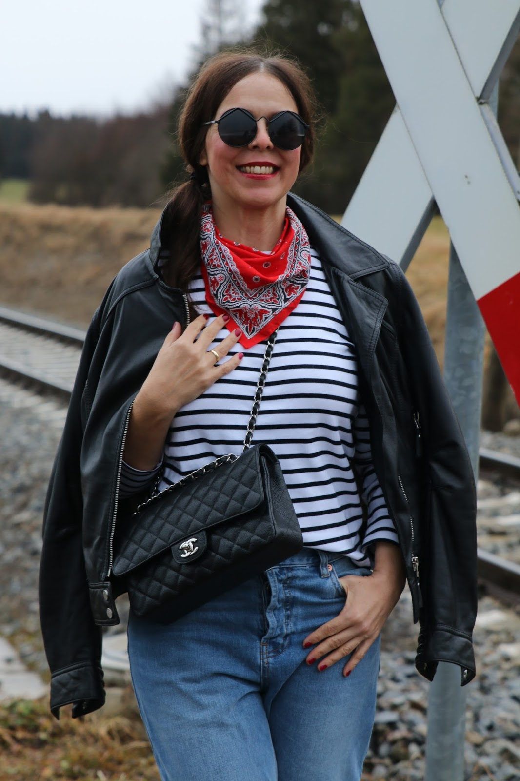 Outfit black leather jacket, striped shirt, red neckerchief, blue mom jeans, black boots