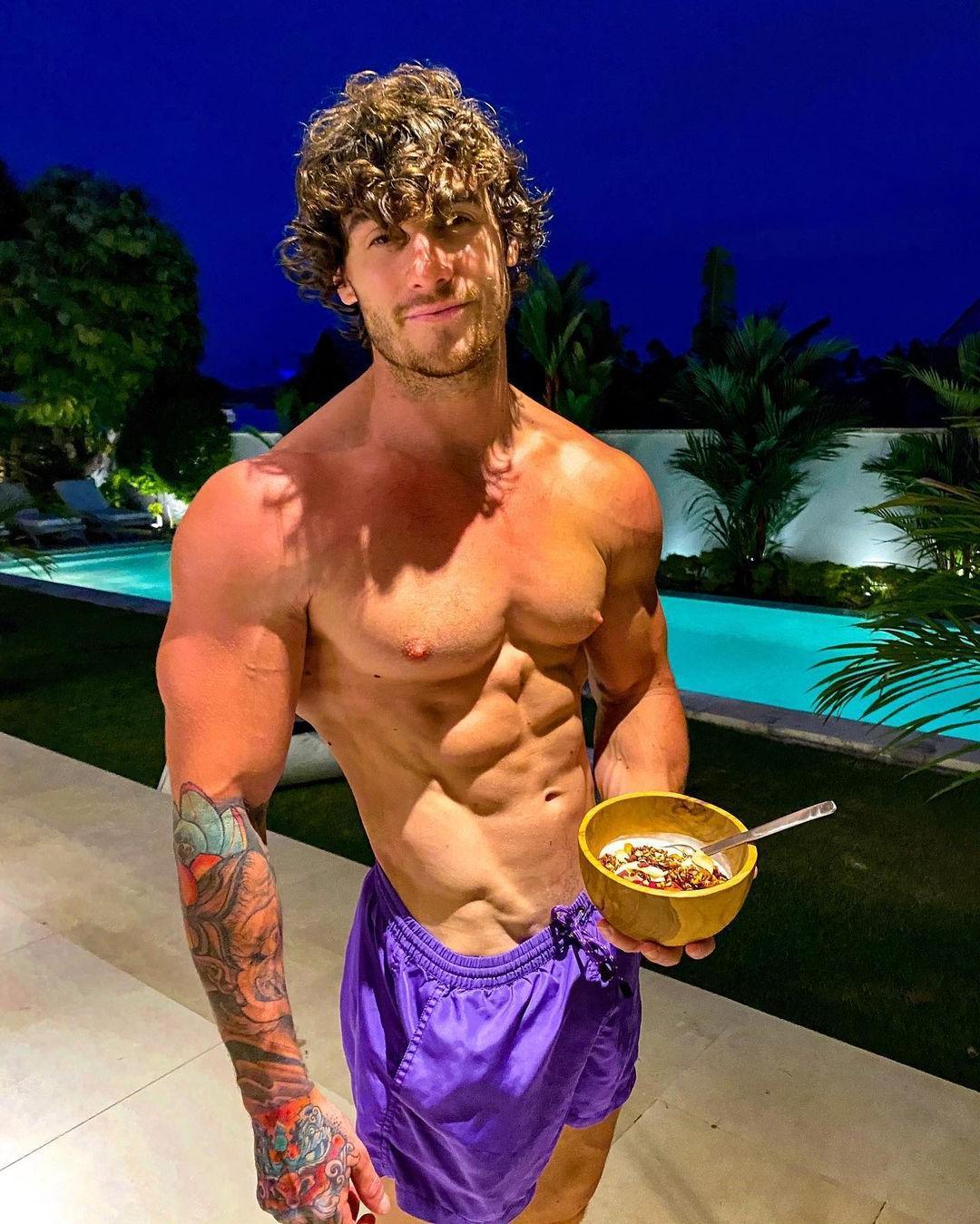 cute-curly-guys-owen-harrison-shirtless-muscular-body-perky-pecs-pointy-nips-eating-muesli