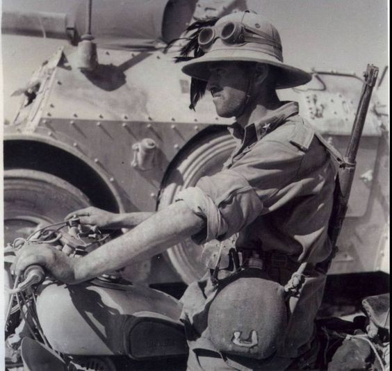 A Bersagliere on the Motoguzzi,and beside an Autoblinda AB-41, North Africa