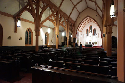 Interior photo of church looking toward the alter from the entrance