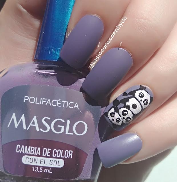 manicura con esmalte fotocromatico en color lila oscuro