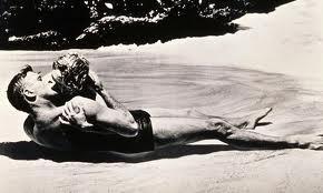 Lancaster & Kerr kissing on the beach