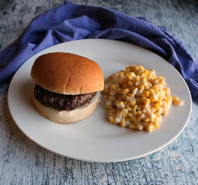 hamburger and creamy corn on plate