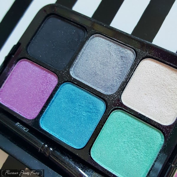 open 6 pan eyeshadow palette with black, grey, ivory, lilac, blue and green colours
