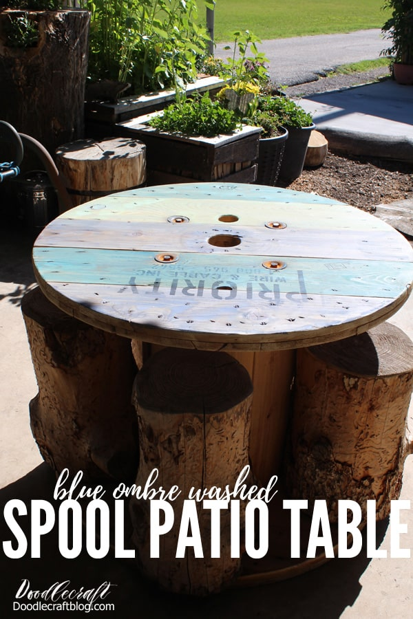 How to make a Blue Ombre Spool Patio Table Upcycle!This spool table has a fun nautical vibe and it's perfect for sitting on the patio for lunch! This blue finish is not quite ombre, but has variegated blue tones for the perfect Summer-ocean inspired furniture upcycle.