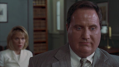 "Robert John Burke, an obese lawyer, is confronted by his wife (Lucinda Jenney) and told to go on a diet in a movie still for the 1996 Stephen King horror film adaptation ""Thinner"""