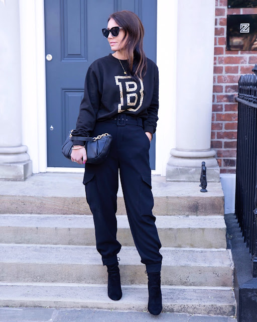 woman in all black casual chic outfit