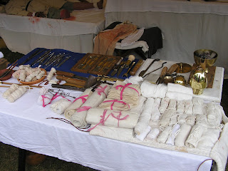 Rolled bandages and medical equipment laid out on a table