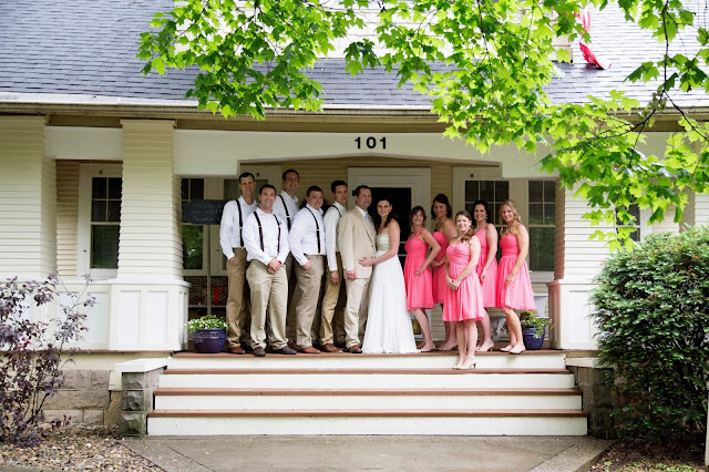 Evie and Josh Leichtenberg wedding photo on front steps of their Sears Elmwood