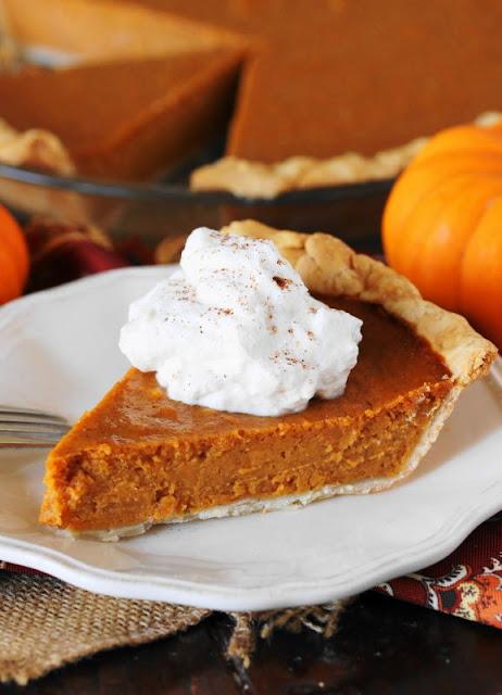 Slice of Sweet Potato Pumpkin Pie with Whipped Cream Image
