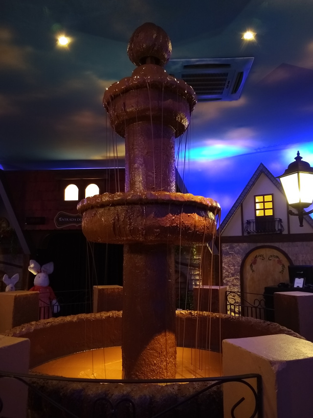 A dark chocolate fountain.