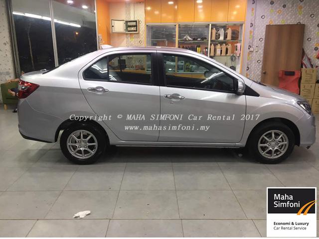 Perodua bezza 1.3 auto silver tepi