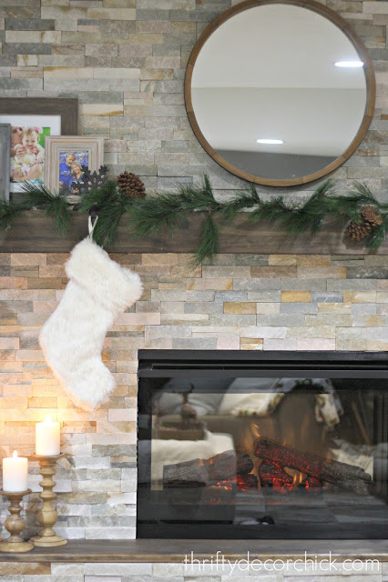 wood mantel on stone fireplace