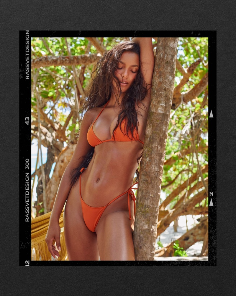 Flaunting her body, Lais Ribeiro poses for Tropic of C swimsuit campaign.