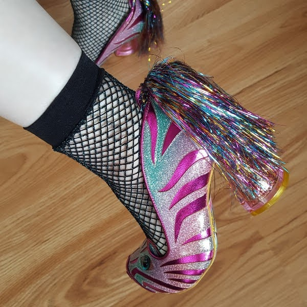 wearing fishnet socks and metallic pink and green zebra shoes by Irregular Choice