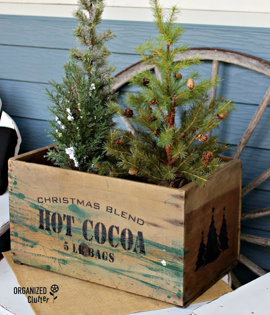 A crate stenciled for Christmas hot cocoa.